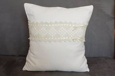 cream pillow with crochet lace