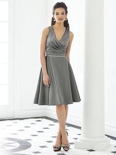 Sleeveless cocktail length matte satin v-neck dress. Draped surplice bodice w/ modified circle skirt. Lux chiffon covered silver sequin belt always matches dress. Also available full length as style 6648.  http://www.dessy.com/dresses/bridesmaid/6647/