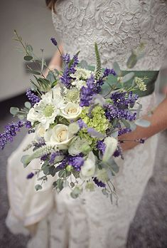 Brides.com: . Her picked-from-a-garden bouquet was made of lavender and white roses.