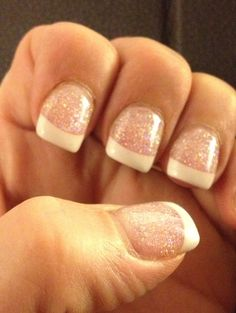 French manicure with glitter gel on the nail and white tips.