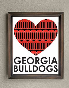 This colorful University of Georgia Heart print is an original pattern, designed with the Georgia Bulldogs colors and symbols in mind. This print come in a variety of sizes (please see drop down menu on the right).  This print can come with or without the words, Georgia Bulldogs (please see drop down menu on the right).  This unique Georgia Bulldogs Heart print looks great by itself, or on a gallery wall with other prints. It would be a perfect gift for holidays, birthdays, or housewarming…
