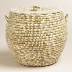 One of my favorite discoveries at WorldMarket.com: Large White Round Piper Tote Basket with Lid