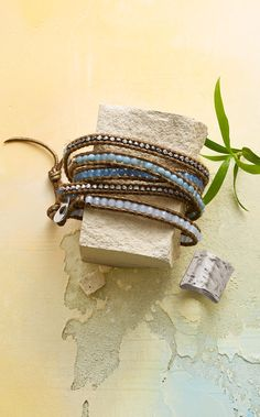 Chan Luu plays with blue lace agate, periwinkle quartz and silver nuggets in this supple leather bracelet. Perfect with denim, it wraps around your wrist any way you'd like. Sterling silver button closure.