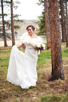 Colorado mountain wedding, devils thumb ranch, bride wearing fur shawl