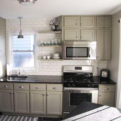 black countertops, grey cabinets, white tile back splash