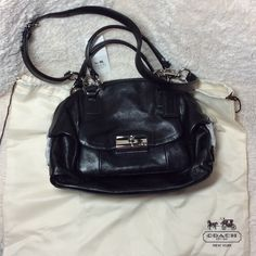 NWT COACH Kristin Leather Dome Satchel NWT COACH Kristin Leather Dome Satchel Black leather with silver trim. Luxe oval links and the distinctive Kristin clasp. Inside zip, cell phone and multifunction pocket. Zip top closure. Fabric lining. Outside pocket. Handles with 6 inch drop. Longer strap for shoulder wear. 12 1/2 X 7 1/2 X 5 inches. Coach Bags Satchels