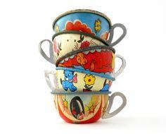Vintage tin teacups.  I still find painted metal toys fascinating!  BP
