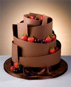 A delicious chocolate wedding cake with strawberries and cherries10 Dreamy Dresses  Ideas for brides via Hitched .  . Steelasophical Steel Band & DJ Wedding Day Music www.steelband.co.uk