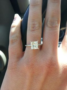 Perfection, tiny diamonds on band surrounding the big diamond, little more bling than just a metal band