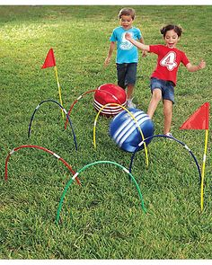 kick croquet game, make with hula hoops and large balls striped with tape. fun