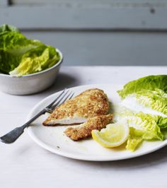 As if breaded chicken wasn't delicious enough, James Martin adds chopped nuts, parmesan, thyme and lemon zest to the breadcrumbs