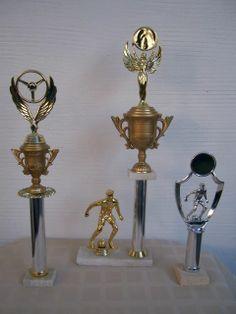 Modelos de trofeos para fútbol y deporte motor (automovilismo, karting).