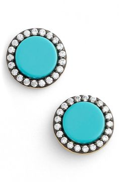 Loving the halo of crystals around the turquoise semi-precious stones on these sparkling stud earrings.