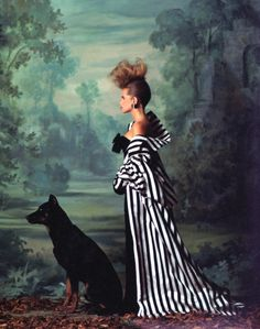 One of Snowdon's most memorable pictorials featured French actress Isabelle Pasco as the Marquise de la Robe Merveille, 'the couturiers' favorite client', in Vogue's September issue for 1985. Here Pasco dons a striped satin trench by Chanel, inspired by the striped bustles worn in the 1870s. Pasco's dog, a Beauceron charmingly named Zozo, was also in the pictorial. Beaucerons are an ancient breed of French sheepdog, once used to hunt wild boar. Photo from ...