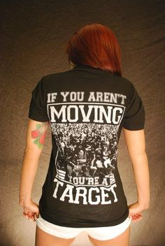 "This shirt says it all: ""If you aren't moving - you're a target.""    A part of our spring 2014 line.  Only from Arnar Clothing.  NOTE: This tee is printed on a crew neck tee shirt, not a small V as pictured in the second image."
