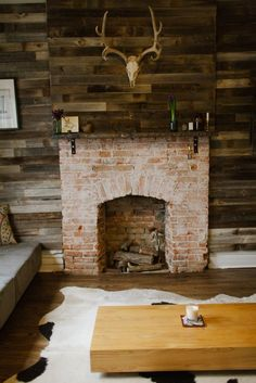 "Brick fireplace in Bridget & Jake's ""Make It Your Own"" Denver Homestead"