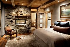 Inspiring Rough Accent for Strong Rustic Bedroom Interior Design Ideas : Cool Modern Electric Fireplace Surrounded By Rustic Stoned Wall Designed With Creepy Reclaimed Wood Mantel Inside Rustic Master Bedroom Modern Rustic Bedrooms, Rustic Bedroom Design, Rustic Master Bedroom, Master Bedroom Design, Cozy Bedroom, Contemporary Bedroom, Bedroom Ideas, Bedroom Designs, Rustic Room
