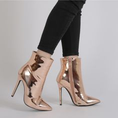 The ultimate future cool ankle boots! Featuring a foil metallic high shine finish these are sure to turn heads. The pointed toe elongates the leg while the stiletto heel adds some sex appeal. Style em up with your best LBD on your next girls night out.  Heel Height: 5\
