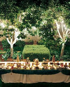The treat-laden dessert table, in all of its sweet glory, was covered with a blanket of velvety moss.