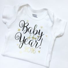 Baby Of The Year Onesie, New Years Onesie, Black and Gold Onesie, New Years by kreationsbychristine on Etsy https://www.etsy.com/listing/256651086/baby-of-the-year-onesie-new-years-onesie