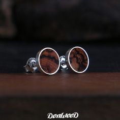 Earrings made from silver and Iron wood