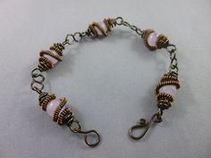 Rose quartz gemstones wrapped in a bronze / copper wire. Wire Wrapped Bracelet, Copper Wire, Pandora Charms, Rose Quartz, Bronze, Charmed, Gemstones, Bracelets, Jewelry