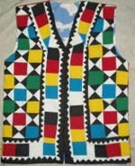 This handmade cotton waistcoat that we make on order. It is a traditional patchwork ralli quilt design piece.