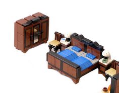 The LEGO modular building line is one of my favorites. Here are a bunch of LEGO furniture ideas I'll borrow from to furnish them! Lego Modular, Lego Design, Table Lego, Lego Furniture, Furniture Ideas, Bedroom Furniture, House Furniture, Cheap Furniture, Minifigures Lego