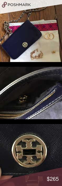 """Navy Blue story Burch Crossbody Bag Dark navy  blue color makes the perfect neutral!  The turnlock opening makes it not only safe to hold your belongs, but also very unique.  Dual interior compartments with center divider; interior zip pocket Logo jacquard lining. Leather. Approx. 9""""W x 5""""H x 1 ½""""D. Unique Braided chain long crossbody strap. Tory Burch Bags Crossbody Bags"""