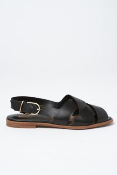 Watch the clouds roll away in the BAY, a slip on sandal with wood sole detail and modern buckle closure. By Dolce Vita Upper: Leather Heel Height: Buckle Wood Sole Buy Shoes, Me Too Shoes, Everyday Shoes, Cute Sandals, Sustainable Clothing, Summer Shoes, Leather Sandals, Fashion Shoes, Shoe Bag