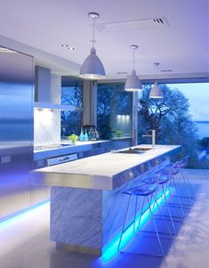 I really like this idea of LED lighting under counter, near floor; but would want it done in white lights, not blue.