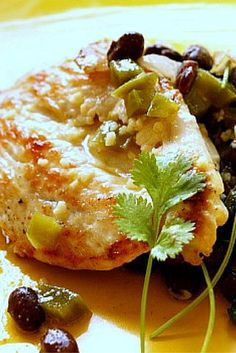 An easy main course Latin Chicken Breast Recipe. Chicken cutlets are lively in flavor with orange juice and jalapeno. Served with black beans, this is a healthy main course meal.