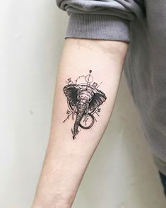 small elephant head tattoo on the forearm