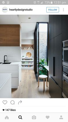 Pantry storage. Black. Herringbone tile. Timber