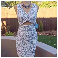 CeCe by Cynthia Steffe Dress Pretty off-white dress with black print and cutout detail in front. Brand new and unworn. Cotton/poly/spandex blend with lined skirt. From a pet and smoke free home. Cynthia Steffe Dresses Midi