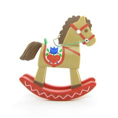 This vintage Hallmark Keepsake Ornament features a rocking horse from Christmas 1980. The rocking horse is light brown with a dark brown mane and tail and has a saddle with Scandinavian style folk art