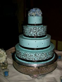 The scroll design is popular among brides, as well as using a cake stand to accent the cake.