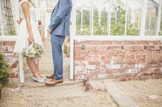 Image by Sarah-Jane Ethan Photography - Short off the shoulder lace prom wedding dress with Rachel Simpson Shoes for an intimate ceremony in Northumberland with home grown flowers and groom in French Connection suit.