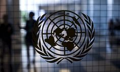 A United Nations logo is seen on a glass door in the Assembly Building at the United Nations headquarters in New York City