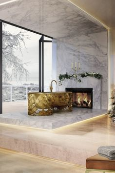A wintery backdrop provides intensely beautiful scenery for this dazzling golden bathroom with warm and cozy details