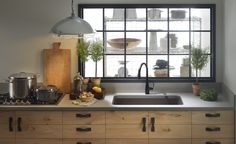 This Kohler kitchen is amazing. It's the perfect mix of modern and rustic.