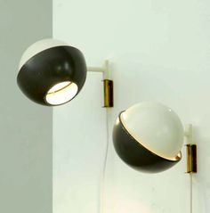 Svea Winkler; Enameled Metal and Brass Wall Lights for Idman Oy, 1950.