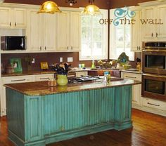 Kitchen:  Love the white cabinets with the distressed turquoise island and wood floors.