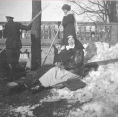 Grand Duchess Olga Alexandrovna in her nurse uniform playing in the snow with her eldest nieces, Grand Duchess Olga and Grand Duchess Tatiana.