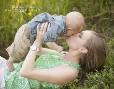 mom kissing baby in sumer field at sunset natural light photography winston salem nc