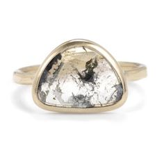 Featuring enchanting natural rutilations, this diamond slice ring has a unique shape and is handcrafted from recycled gold.