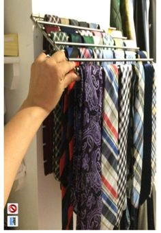 Use IKEA's Lamplig trivet as a tie rack. Attach to the wall with two cup hooks. Lays flat.
