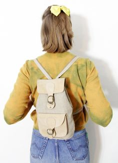 50% OFF SALE Vintage backpack / small beige canvas and leather rucksack. $19.00, via Etsy.