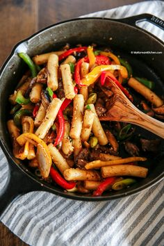Gungjung Tteokbokki (Korean royal court rice cakes) recipe. This is a non-spicy Korean rice cake recipe. Stir fried with soy sauce, beef and vegetables. | MyKoreanKitchen.com