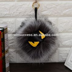 new style MONSTER face long faux raccoon fur pom poms keychain